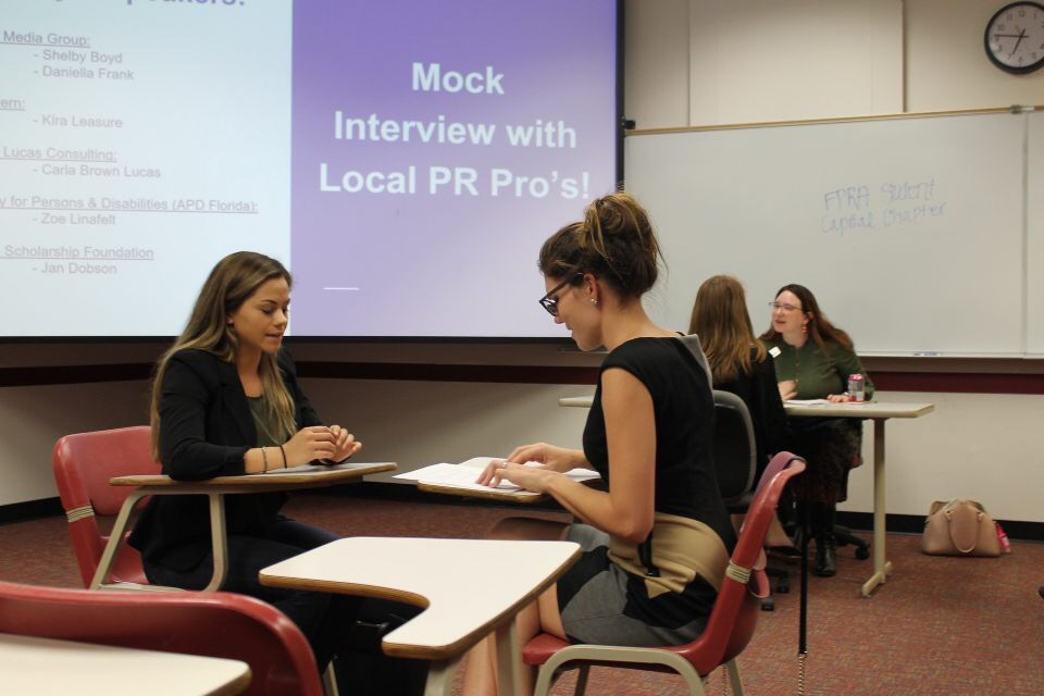 Communications student conducting mock interview with local PR pro